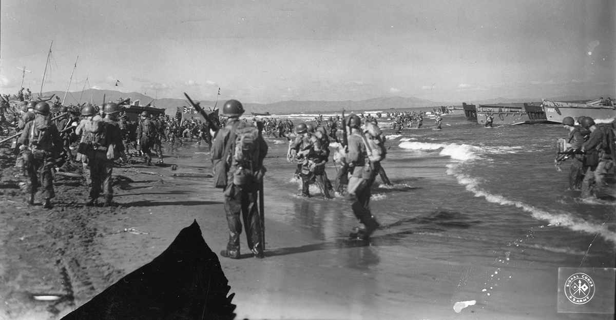 Black and white photo of Soldiers on beach.