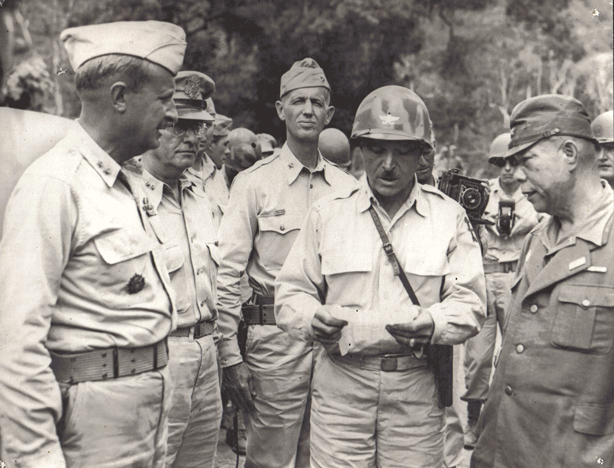 Black and white photo of commander reading surender.