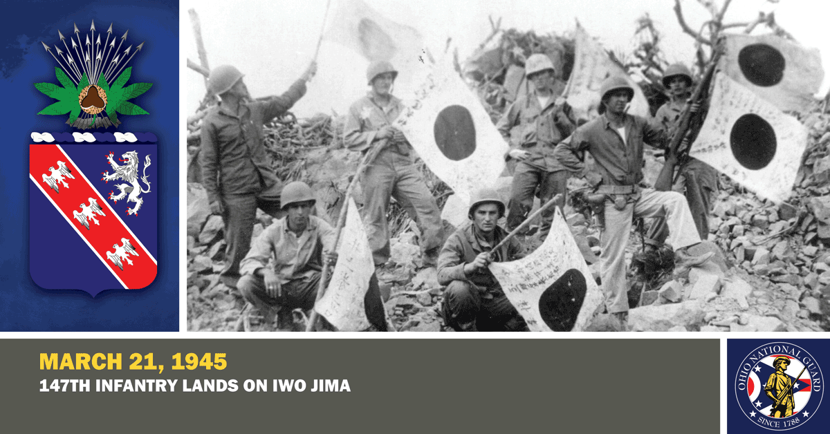 Soldiers hold Japanese flags.