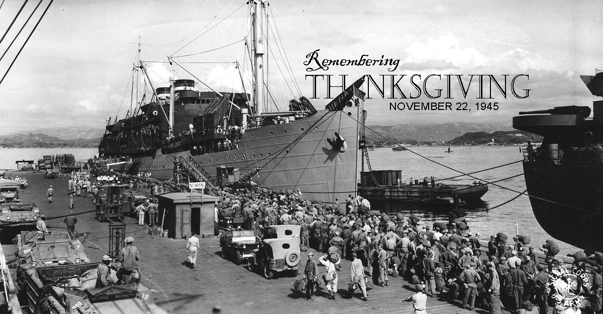 KBlack and white image of Soldiers lining the dock preparing to board ship.