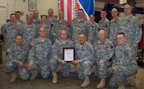 Employees of Field Maintenance Shop 17 at Camp Perry in Port Clinton show off a certificate awarding the facility the ISO 9001:2008 certification.  (Ohio National Guard photo