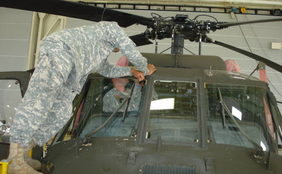 Soldiers from the Ohio Army National Guard's Company D, 1st Battalion, 137th Aviation Regiment perform maintenance on a UH-60 Black Hawk helicopter