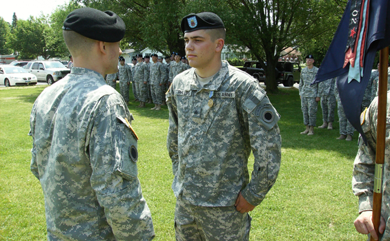 Sgt. Mark Phillips of Company C, 1st Battalion, 148th Infantry Regiment, receives an Army Achievement Medal June 11, 2011