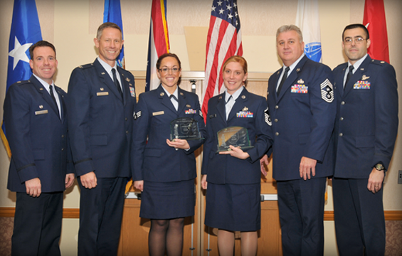 Senior Airman Madeline Carpenter (third from left) and Master Sgt. Jaime Chinn (fourth from left), both members of the 178th Fighter Wing, Springfield, Ohio, pose for a photo with their wing leadership Dec. 1, 2012, during the Ohio Airman of the Year awards banquet in Dublin, Ohio.