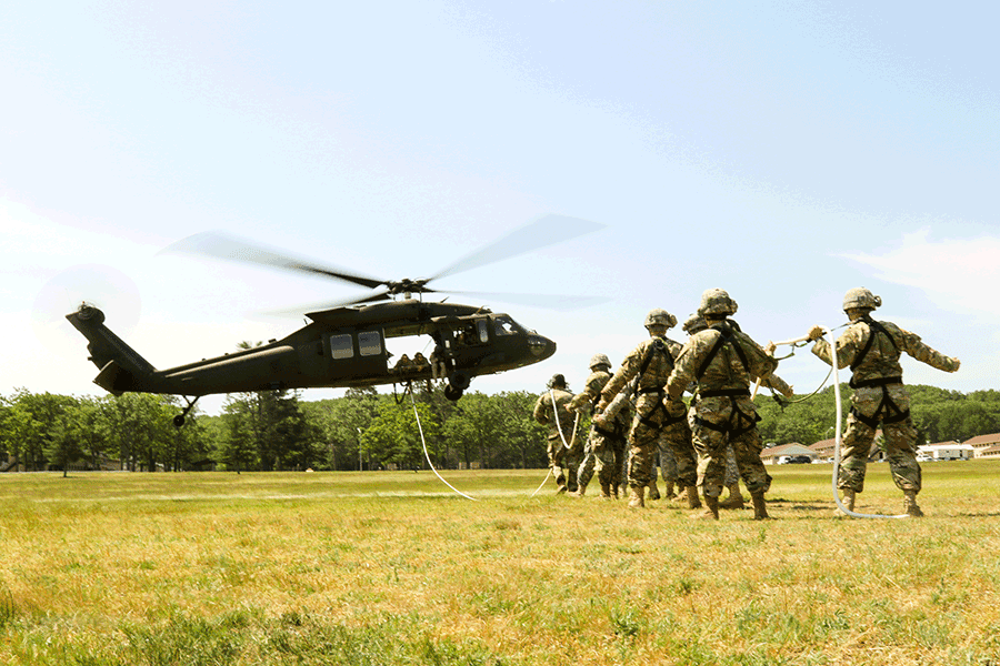 Soldiers preparing for helicoptor transfer exercise
