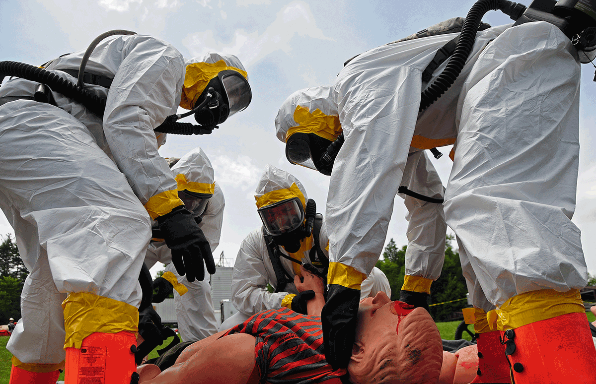 Soldiers in hazmat suits tend to victim.