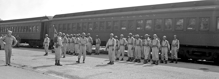 Soldiers from Battery B, 137th AAA Bn. stand in formation after getting off of a Boston and Albany train at Camp Perry.