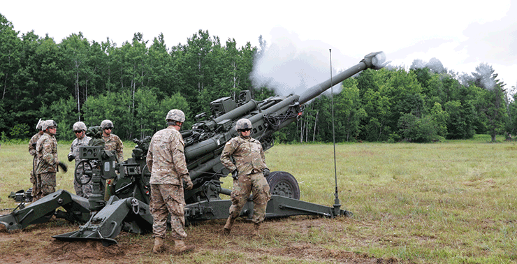 Soldiers with Battery C, 1st Battalion, 134th Field Artillery Regiment fire the M777 howitzer during a live-fire exercise.