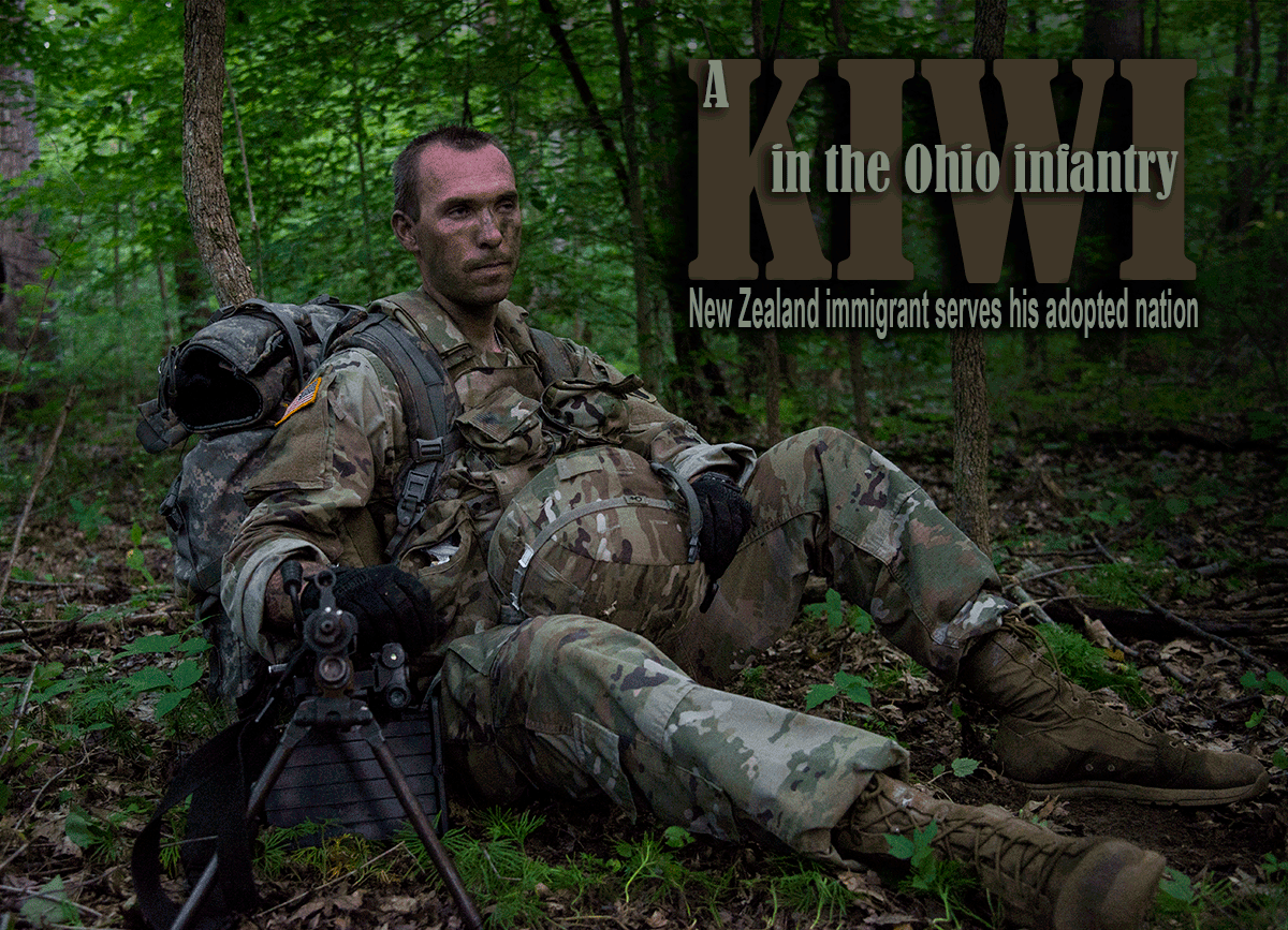 Soldier in camo sitting in woods