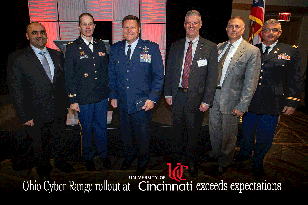 Representatives from the Ohio Adjutant General's Department and the University of Cincinnati stand for a photo June 19, 2019, during the university's Cybersecurity Education Symposium to celebrate the completion of the second phase of the rollout of the Ohio Cyber Range. The next phase of the OCR rollout will see the power of the computing system at UC doubled and an identical system installed at the University of Akron.