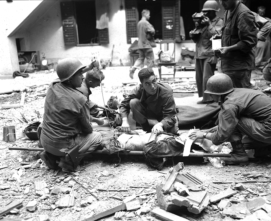 Medics give plasma to a Soldier.