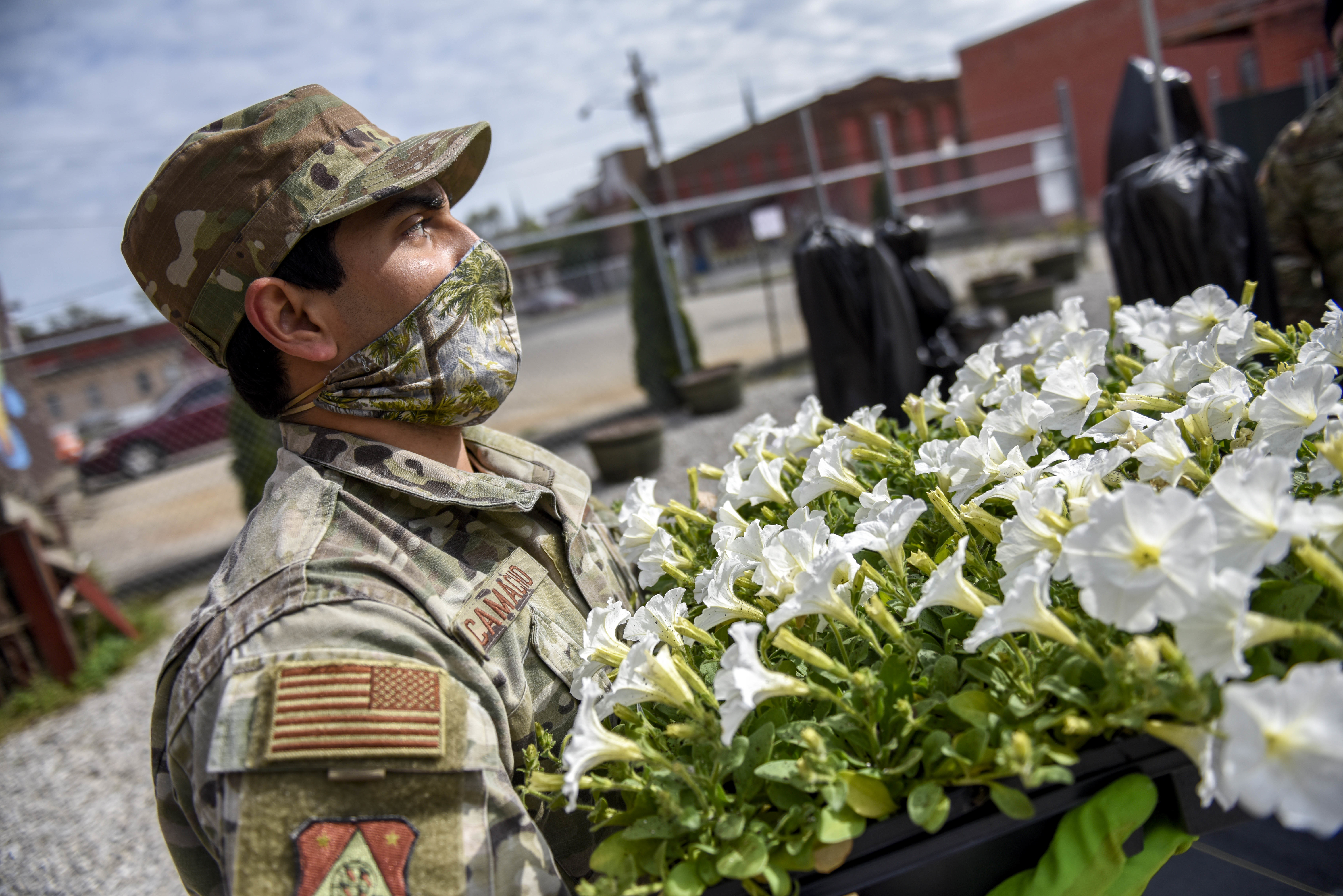 Soldier carries flowers