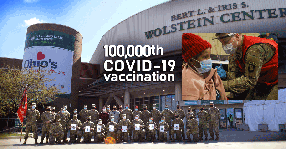 Soldiers and Airmen stand for group shot in front of Auditorium, with super-imposed image of 100,000th recipient getting their shot.